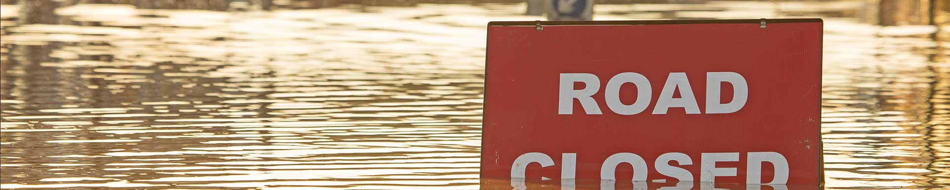 flooded road closed sign